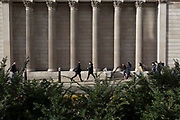 On the day that Chancellor of the Exchequer Rishi Sunak unveiled a £30bn package to boost the economy and get the country through the coronavirus outbreak, Londoners walk towards each other beneath the pillars and columns of the Bank of England as its governor Mark Carney cut the interest rate from 0.75% to 0.25%, on 11th March 2020, in the City of London, England.