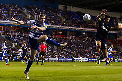 Jon Dadi Bodvarsson of Reading clears the ball from Tom Lawrence of Derby County - Mandatory by-line: Robbie Stephenson/JMP - 03/08/2018 - FOOTBALL - Madejski Stadium - Reading, England - Reading v Derby County - Sky Bet Championship