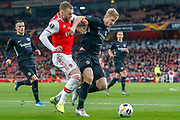 Arsenal defender Calum Chambers (21) battles with Eintracht Frankfurt defender Martin Hinteregger (13) during the Europa League match between Arsenal and Eintracht Frankfurt at the Emirates Stadium, London, England on 28 November 2019.