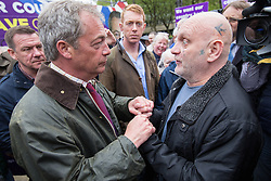 © Licensed to London News Pictures . 25/05/2016 . Bolton , UK . A man speaks to NIGEL FARAGE . The UKIP referendum bus tour , campaigning for a UK Brexit , lead by Nigel Farage , in Victoria Square , Bolton . Photo credit : Joel Goodman/LNP