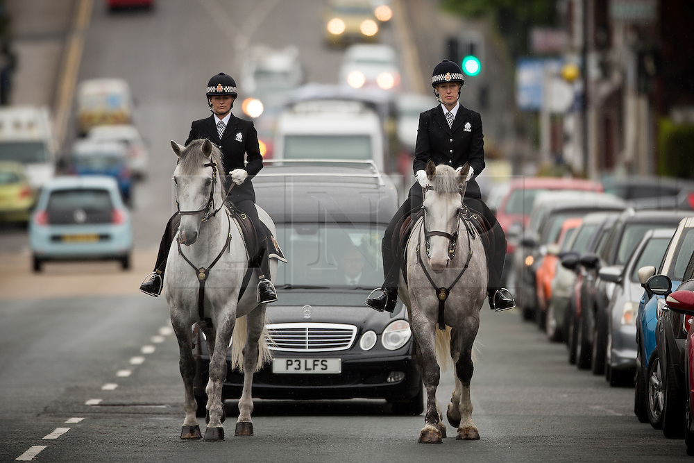 © Licensed to London News Pictures . 15/07/2016 . Bolton , UK . The cortege , lead by two mounted police , arrives at the church . The funeral of Special Constable Samantha Derbyshire at St Mary's RC Church in Horwich , Bolton. Derbyshire was struck and killed by an HGV on the M61 motorway following a collision , in the early hours of Monday 11th July 2016 . Photo credit : Joel Goodman/LNP