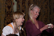 """Tamra Francis (left) watches an audience member try to make a pretzel during Mayhem & Mystery's production of """"Festival Fracas"""" at the Spaghetti Warehouse in downtown Dayton, Monday, September 27, 2010."""