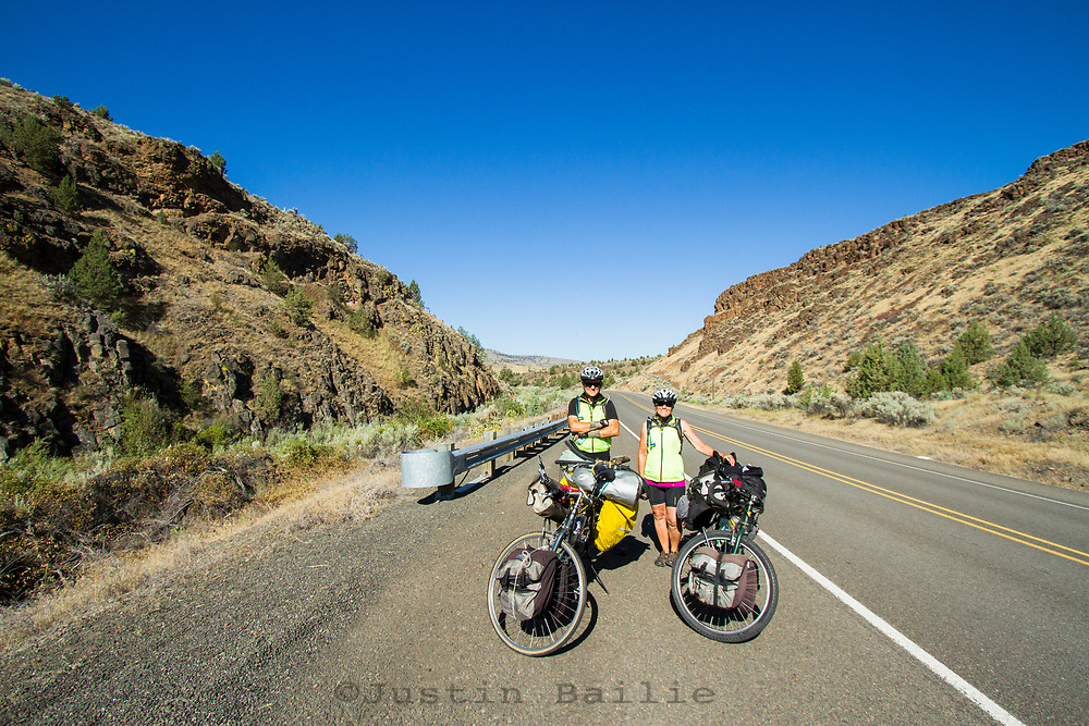 Older couple biking accross the United states. Eastern Oregon; Highway 26.