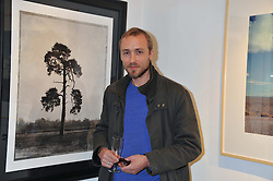 SAM PELLY at a private view of photographs by various photographers entitled 'From The Road' held at Eleven, 11 Eccleston Street, London SW1 on 19th January 2012.