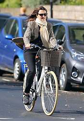 (EXCLUSIVE PICTURES) Actress Rachel Weisz wearing dark shades, scarf, check blazer, blue top, black jeans and trainers, was spotted riding her bike around London... 20/09/2019<br /> BYLINE MUST READ : JAMESY/GOTCHA IMAGES<br /> <br /> Copyright by © Gotcha Images Ltd. All rights reserved.<br /> Usage of this image is conditional upon the acceptance <br /> of Gotcha Images Ltd, terms and conditions available at<br /> www.gotchaimages.com