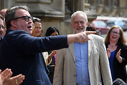 © London News Pictures. 09/05/2016. London, UK. Labour deputy leader TOM WATSON seen pointing in front of Leader of the Labour Party, JEREMY CORBYN, as he greets new Labour MPs Chris Elmore and Gill Furniss (not pictured) outside the Houses of Parliament in London following elections last week. Photo credit: Ben Cawthra/LNP