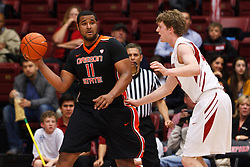 Feb 16, 2012; Stanford CA, USA; Oregon State Beavers forward/center Joe Burton (11) is defended by Stanford Cardinal forward/center John Gage (40) during the first half at Maples Pavilion.  Mandatory Credit: Jason O. Watson-US PRESSWIRE