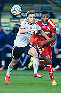 (L) Legia's Bartosz Bereszynski fights for the ball with (R) Wisla's Emmanuel Saki during T-Mobile ExtraLeague soccer match between Legia Warsaw and Wisla Krakow in Warsaw, Poland.<br /> <br /> Poland, Warsaw, March 15, 2015<br /> <br /> Picture also available in RAW (NEF) or TIFF format on special request.<br /> <br /> For editorial use only. Any commercial or promotional use requires permission.<br /> <br /> Mandatory credit:<br /> Photo by © Adam Nurkiewicz / Mediasport