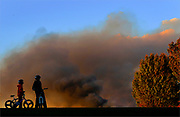 Smoke from the large brush fire fills the sky over River Road Park in Sayreville on November 3, 2010. The large fire burned down at least 100 acres along the Raritan River in Edison.