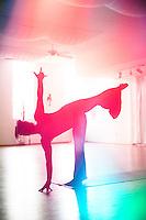 Rainbow silhouette of the yoga pose Half Moon.
