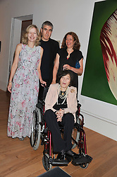 Left to right, FLORA BROOKES, ADAM McEWEN, SAM McEWEN with their mother ROMANA McEWEN at a private view of work by the late Rory McEwen - The Colours of Reality, held at the Shirley Sherwood Gallery, Kew Gardens, London on 20th May 2013.