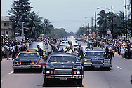 President Carter during a parade in Monrovia, Liberia. President William Tolbert is with  Carter in the limo.<br /> Photo by Dennis Brack