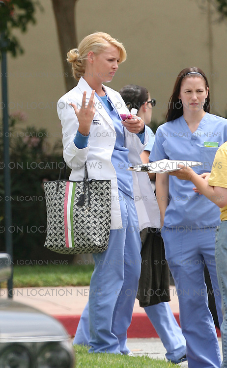 LOS ANGELES, CALIFORNIA - MONDAY 4TH AUGUST 2008 NON EXCLUSIVE: Patrick Dempsey And Katherine Heigl make their way back to their trailers on the set of Grey's Anatomy. Photograph: On Location News. Sales: Eric Ford 1/818-613-3955 info@OnLocationNews.com