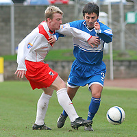 Airdie Stephen McKeown and St Johnstone's Goran Stanic in action in the Scottish First Division match played at Mc Diarmid Park 20th January 2007.