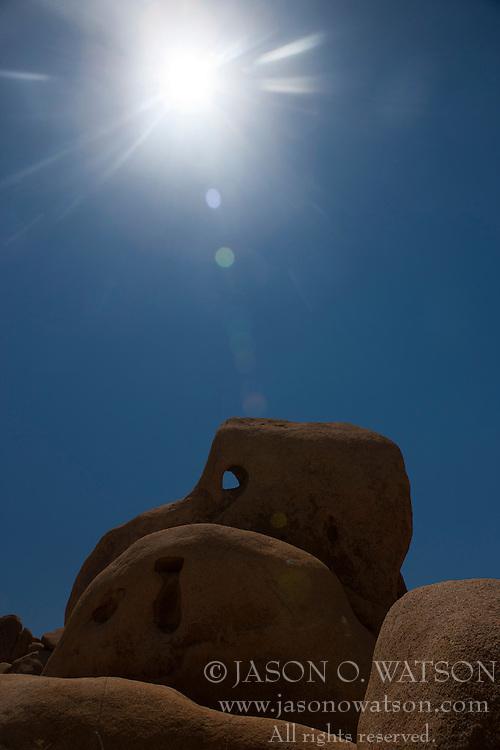 Skull Rock with sun overhead, Joshua Tree National Park, California, United States of America