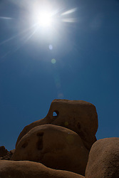 Skull Rock with sun overhead, Joshua Tree National Park, California, United States of America