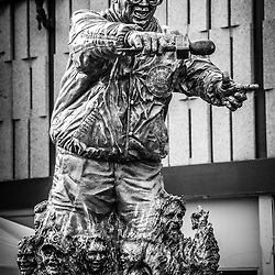 """Harry Caray statue at Wrigley Field in black and white. Harry Caray was a very popular announcer for the Chicago Cubs and is known for leading fans in singing """"Take Me Out to the Ball Game"""" during the seventh inning stretch."""