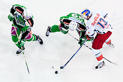 Petr Sachl (HDD Tilia Olimpija, #12) and Ziga Pance (HDD Tilia Olimpija, #19) vs Michael Schiechl (EC Red Bull Salzburg, #13) during ice-hockey match between HDD Tilia Olimpija and EC Red Bull Salzburg in 20th Round of EBEL league, on November 6, 2011 at Hala Tivoli, Ljubljana, Slovenia. HDD Tilia Olimpija won in overtime 3:2. (Photo By Matic Klansek Velej / Sportida)