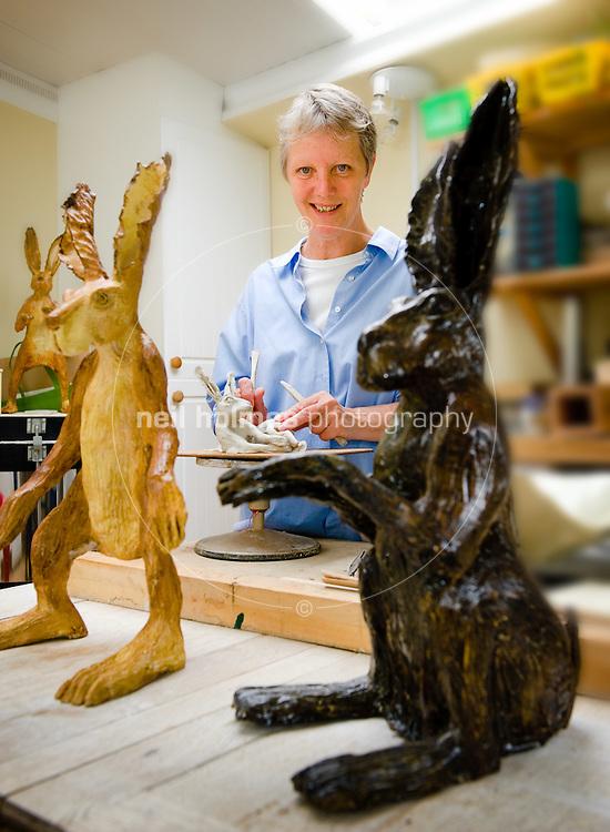 Ceramic artist Denise Hayhurst working in her studio in Kilham village