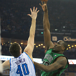 11 February 2009:  Boston Celtics center Kendrick Perkins (43) shoots over New Orleans Hornets forward Ryan Bowen (40) during a NBA game between the Boston Celtics and the New Orleans Hornets at the New Orleans Arena in New Orleans, LA.