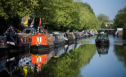 © Licensed to London News Pictures. 06/05/2018. London, UK. A canalboat makes its way along Grand Union Canal as day two of the Canalway Cavalcade festival takes place in Little Venice, West London on Sunday,  May 6th 2018. Inland Waterways Association's annual gathering of canal boats brings around 130 decorated boats together in Little Venice's canals on May bank holiday weekend. Photo credit: Ben Cawthra/LNP
