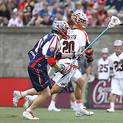 Jeremy Sieverts #20 of the Denver Outlaws runs with the ball past Matt Smalley #11 of the Boston Cannons during the game at Harvard Stadium on May 10, 2014 in Boston, Massachusetts. (Photo by Elan Kawesch)