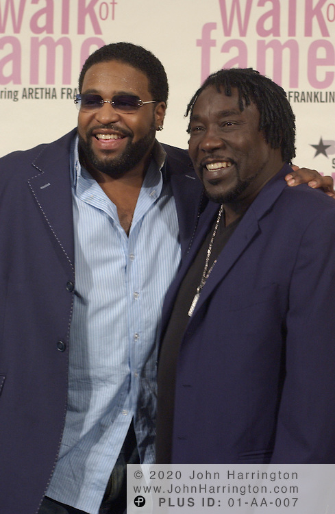 From right: Eddie and Gerald Levert backstage at BET's 9th annual Walk of Fame honoring Aretha Franklin on Saturday October 18, 2003.