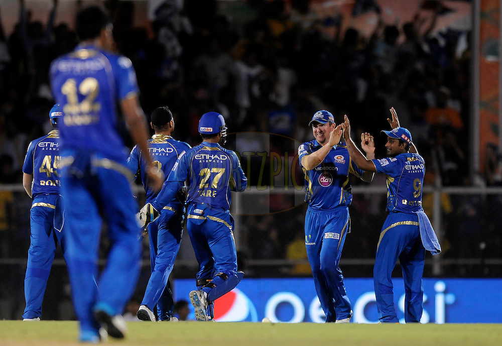 Ben Dunk of the Mumbai Indians celebrates after taking a catch to get the wicket of Faf du Plessis of The Chennai Superkings during the eliminator match of the Pepsi Indian Premier League Season 2014 between the Chennai Superkings and the Mumbai Indians held at the Brabourne Stadium, Mumbai, India on the 28th May  2014<br /> <br /> Photo by Pal PIllai / IPL / SPORTZPICS<br /> <br /> <br /> <br /> Image use subject to terms and conditions which can be found here:  http://sportzpics.photoshelter.com/gallery/Pepsi-IPL-Image-terms-and-conditions/G00004VW1IVJ.gB0/C0000TScjhBM6ikg