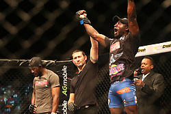 Basambombo Mutuale (Red) looks on as Kaleka Kabanda (Blue) celebrates the win during the second bout of the Extreme Fighting Championships, EFC 52 held at the Grand West Casino in Cape Town, South Africa on the 5th August 2016<br /> <br /> Photo by:   Shaun Roy / Real Time Images
