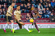Uche Ikpeazu (#19) of Heart of Midlothian FC shoots for goal during the Betfred Scottish Football League Cup quarter final match between Heart of Midlothian FC and Aberdeen FC at Tynecastle Stadium, Edinburgh, Scotland on 25 September 2019.