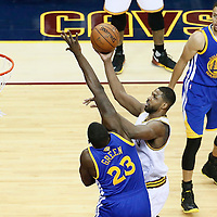 10 June 2016: Cleveland Cavaliers center Tristan Thompson (13) goes for the layup against Cleveland Cavaliers forward LeBron James (23) next to Golden State Warriors guard Stephen Curry (30) during the Golden State Warriors 108-97 victory over the Cleveland Cavaliers, during Game Four of the 2016 NBA Finals at the Quicken Loans Arena, Cleveland, Ohio, USA.