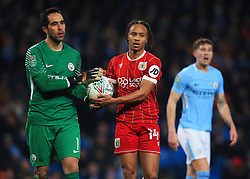 Bobby Reid of Bristol City takes the ball off Claudio Bravo of Manchester City before the penalty - Mandatory by-line: Matt McNulty/JMP - 09/01/2018 - FOOTBALL - Etihad Stadium - Manchester, England - Manchester City v Bristol City - Carabao Cup Semi-Final First Leg