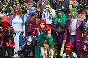 UNITED KINGDOM, London: 27 May 2018 A group of cosplay fans dressed in an array of super hero and villain costumes pose for a picture at the MCM London Comic Con earlier today. The three day comic convention, which is held at London's ExCeL, was visited by thousands of avid cosplay fans and enthusiasts. Rick Findler / Story Picture Agency