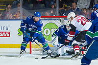 KELOWNA, BC - SEPTEMBER 29:  Dylan Strome #20 of the Arizona Coyotes tries to put the puck past Derrick Pouliot #5 and into the net of Jacob Markstrom #25 of the Vancouver Canucks during first period at Prospera Place on September 29, 2018 in Kelowna, Canada. (Photo by Marissa Baecker/NHLI via Getty Images)  *** Local Caption *** Derrick Pouliot;Jacob Markstrom;Dylan Strome