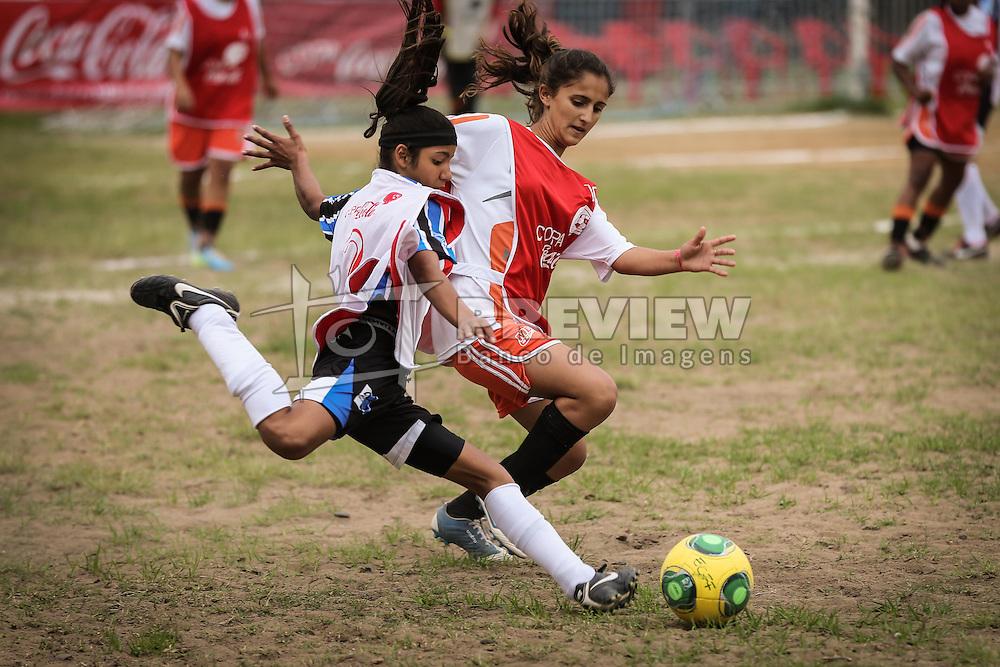 Lance da partida entre as equipes de Parobé Gusch e Escola Conveniada válida pela Copa Coca-Cola 2013. FOTO: Jefferson Bernardes/Preview.com