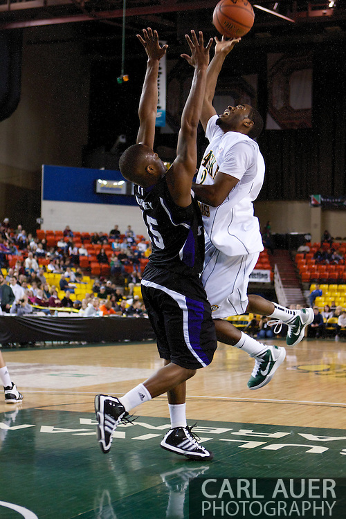 November 25th, 2010:  Anchorage, Alaska - University of Alaska-Anchorage guard Mario Gill (2) takes a shot in the lane in the Seawolves 54-86 loss to Weber State in the first round of the Great Alaska Shootout.