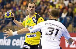 Uros Zorman (#24) of Celje vs Momir Ilic of Kiel during the handball match between RK Celje Pivovarna Lasko (SLO) and TWH Kiel (GER) in 4th Round of Velux EHF Men's Champions League, on October 17, 2010 in Arena Zlatorog, Celje, Slovenia.  (Photo By Vid Ponikvar / Sportida.com)