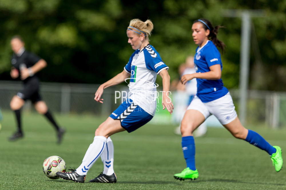 Julie Nelson (Durham Womens FC) passes the ball watched by Jessica King (Everton Ladies) during the FA Women's Super League match between Durham Women FC and Everton Ladies at New Ferens Park, Belmont, United Kingdom on 30 August 2015. Photo by George Ledger.