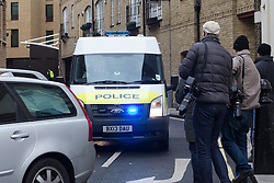 © Licensed to London News Pictures. 07/12/2015. London, UK. Muhaydin Mire leaving Westminster Magistrates Court in custody in an escorted police van after appearing in court this morning charged with attempted murder following a knife attack at Leytonstone Underground station in east London on Saturday.  Photo credit : Vickie Flores/LNP