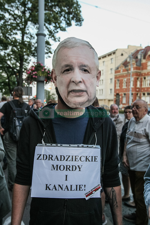 July 20, 2017 - Gdansk, Poland - Protester in Jaroslaw Kaczynski mask during the ' Solidarity Chain of Light ' protest are seen in Gdansk, Poland on 20 July 2017   Crowds gathered outside the Regional Court in Gdansk and other cities around the country to protest at government changes to Polands judicial system. Protesters argued the changes limit judicial independence and threaten the separation of powers in the country. (Credit Image: © Michal Fludra/NurPhoto via ZUMA Press)