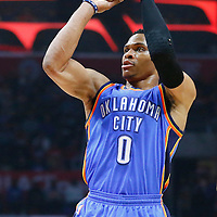 21 December 2015: Oklahoma City Thunder guard Russell Westbrook (0) takes a jump shot during the Oklahoma City Thunder 100-99 victory over the Los Angeles Clippers, at the Staples Center, Los Angeles, California, USA.