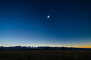 The August 21, 2017 total solar eclipse over the Grand Tetons as seen from the Teton Valley in Idaho, near Driggs. <br /> <br /> This is from a 700-frame time-lapse and is of second contact just as the diamond ring is ending and the dark shadow of the Moon is approaching from the west at right, darkening the sky at right, and beginning to touch the Sun. The peaks of the Tetons are not yet in the umbral shadow and are still lit by the partially eclipsed Sun. <br /> <br /> With the Canon 6D and 14mm SP Rokinon lens at f/2.5 for 1/10 second at ISO 100.