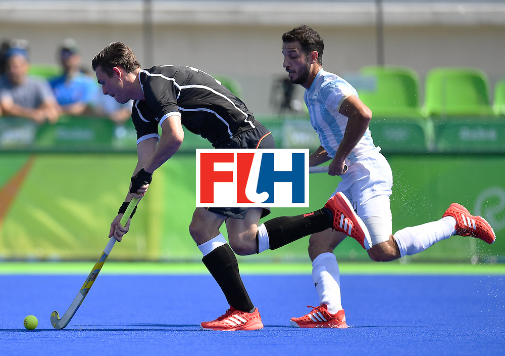Germany's Christopher Wesley (L) vies with Argentina's Manuel Brunet during the men's semifinal field hockey Argentina vs Germany match of the Rio 2016 Olympics Games at the Olympic Hockey Centre in Rio de Janeiro on August 16, 2016. / AFP / MANAN VATSYAYANA        (Photo credit should read MANAN VATSYAYANA/AFP/Getty Images)