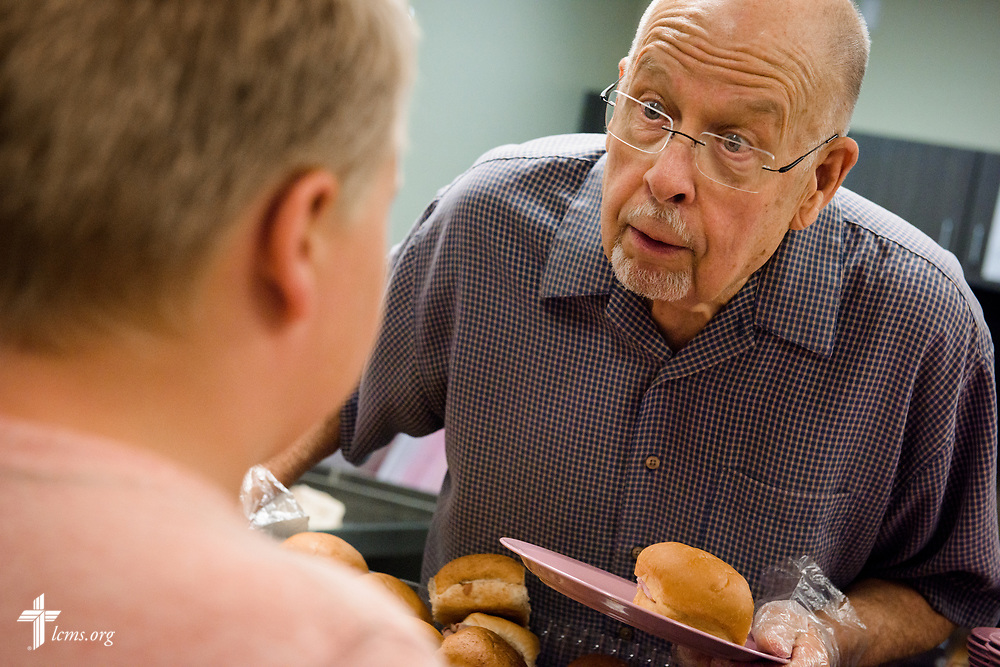 "A volunteer from Faith Lutheran Church, Sioux Falls, SD., serves lunch at the Bishop Dudley Hospitality House homeless shelter on Tuesday, Aug. 1, 2017, in Sioux Falls. The meals are provided by a grant through the ""Stand With Your Community"" program, which was made possible by a partnership between the LCMS, Thrivent Financial and Lutheran Church Extension Fund. LCMS Communications/Erik M. Lunsford"