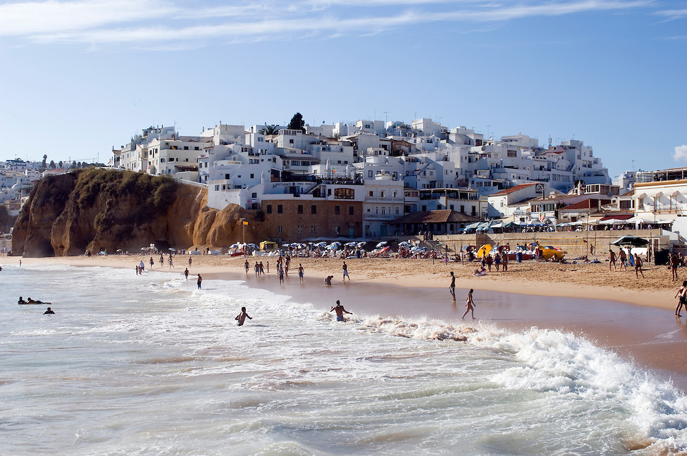 The tourists swimming in the sea at the resort of Albufeira on the Algarve, Portugal