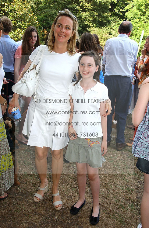 The HON.MRS SOPHIE MONTGOMERY and her daughter LADY CLAUDIA MARQUIS at the Macmillan Cancer Support Dog Day held in the gardens of the Royal Hospital, Chelsea, London on 4th July 2006.<br />