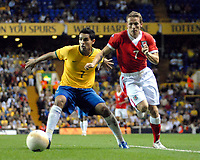Photo: Ed Godden.<br /> Brazil v Wales. International Friendly. 05/09/2006.<br /> Craig Bellamy (R) chases the ball from Alexandro Souza.