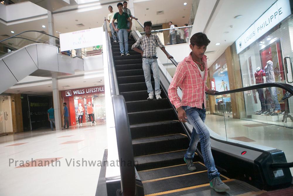 A man gets off a escalator in a mall, in Patna, Bihar, India, on Tuesday October 2, 2012. Photographer: Prashanth Vishwanathan