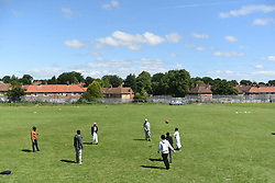 June 25, 2017 - Newcastle Upon Tyne, NORTHUMBERLAND, UK - NEWCASTLE UPON TYNE, UK. Children play football near the scene of fatal car crash at the Westgate Sports Centre on West Road, Newcastle Upon Tyne on 25th June 2017. A car hit worshippers leaveing Eid prayers at there are believed to be at least six people hurt in the incidentc. A 42 year old woman was arrested at the scene. (Credit Image: © Mary Turner/London News Pictures via ZUMA Wire)