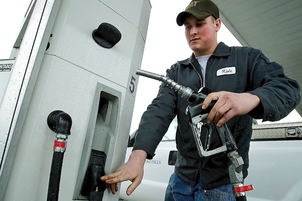 Kyle Rickard, a City of Post Falls employee, replace the gas pump handle after filling one of the fleet vehicle for the city Thursday. Rising gas prices have prompted the City of Post Falls to consider natural gas options for their fleet vehicles.